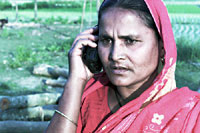 Illiterate woman operates a mobile phone that she has financed through the microcredit organisation Grameen Bank (photo: Michael Lund)